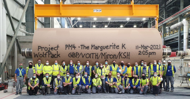 Voith, Voith Paper, Green Bay Packaging, Green Bay Packaging Mill Division, Green Bay Mill, First Reel, Group of Voith workers standing in front of large reel of paper